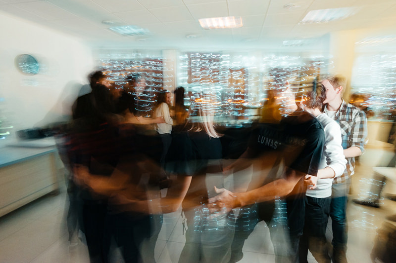 company employees dancing in the office during the New Year party