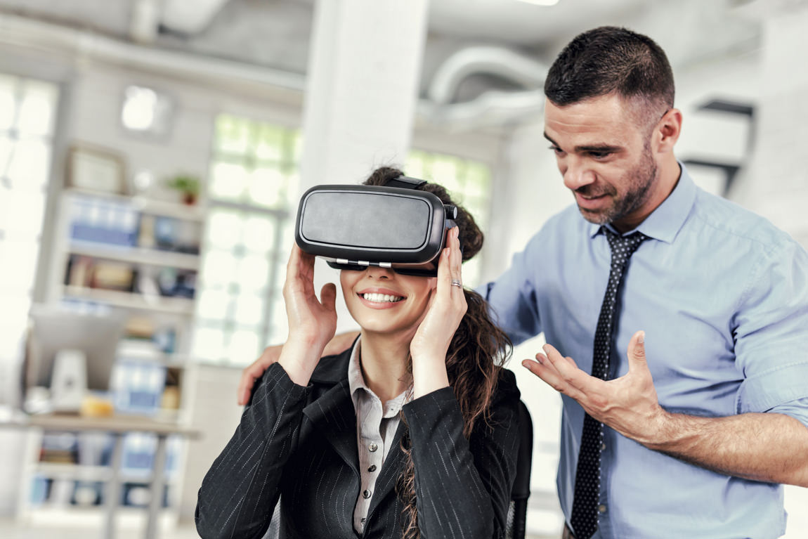 Sales manager demonstrates a client future apartment with VR headset