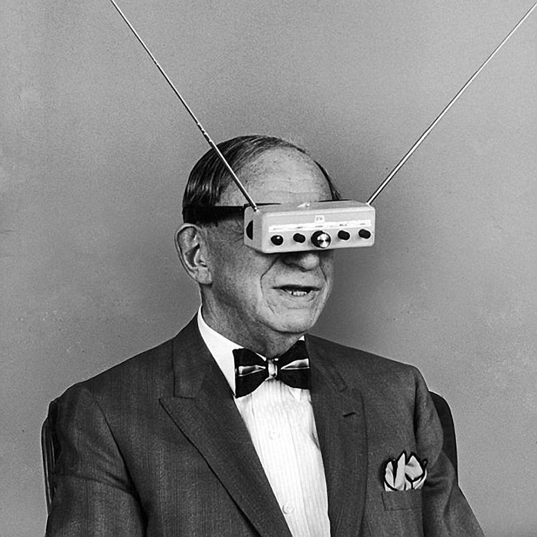 Man with first virtual reality glasses watching 3D images