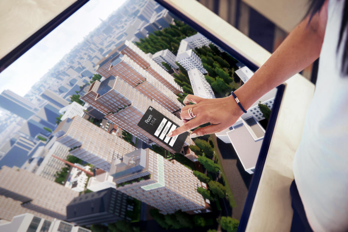 Real estate marketing application shown on big touchscreen display