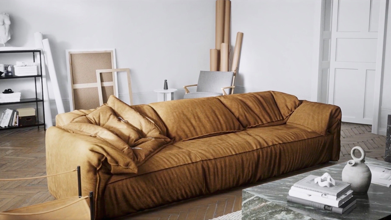 Explore kashmir cognac sofa with one large flat cushion of the same color on the left rendered in the light interior with the help of computer graphics